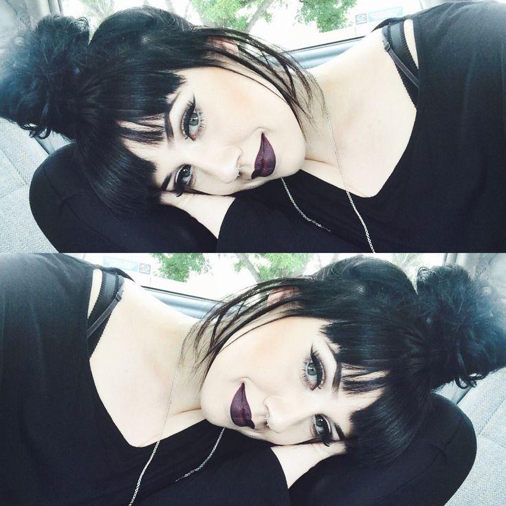 Messy bun and dark lips