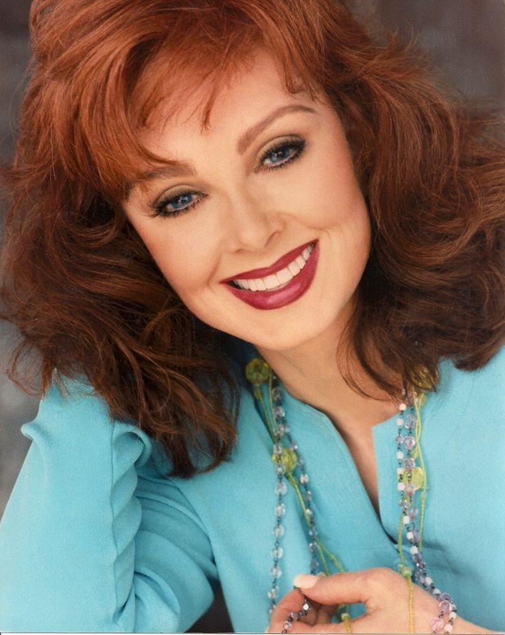 "Xyy'nai Naomi Judd Singer-songwriter Naomi Judd is an American country music singer, songwriter, and activist. As country music's most famous mother–daughter team, The Judds scored  fifteen No. 1s hits and went undefeated for eight consecutive years at all three major country music awards shows. The duo won five Grammy Awards and a vast array of other awards and honors. Naomi, herself, also won a Grammy for Country Song of the Year with the Judds' smash hit ""Love Can Build a Bridge""…"