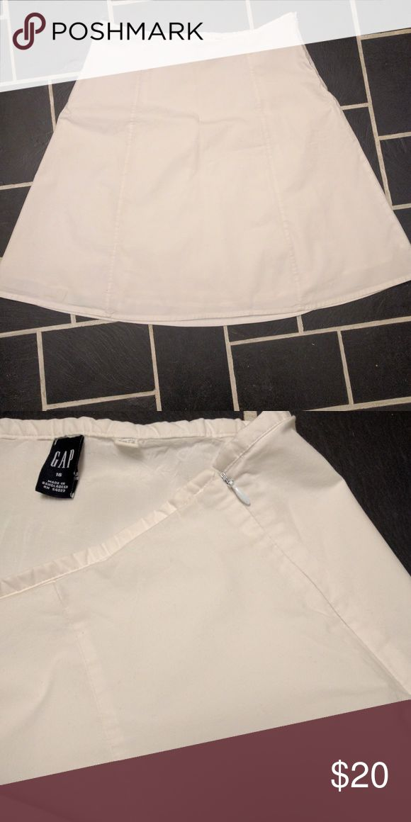 GAP white A-line skirt Need an Easter look?  Great, classic white skirt.  Size 16.  Minimal waistband looks great with a shirt tucked in, or lies very flat under an untucked look.  Fully lined.  Side zipper as shown.  No stains!  About knee length. GAP Skirts