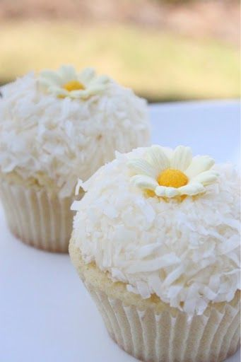 Lemon Coconut Cupcakes - I made the cake from this recipe this weekend and just frosted with a lemon coconut butter cream.  AMAZING!