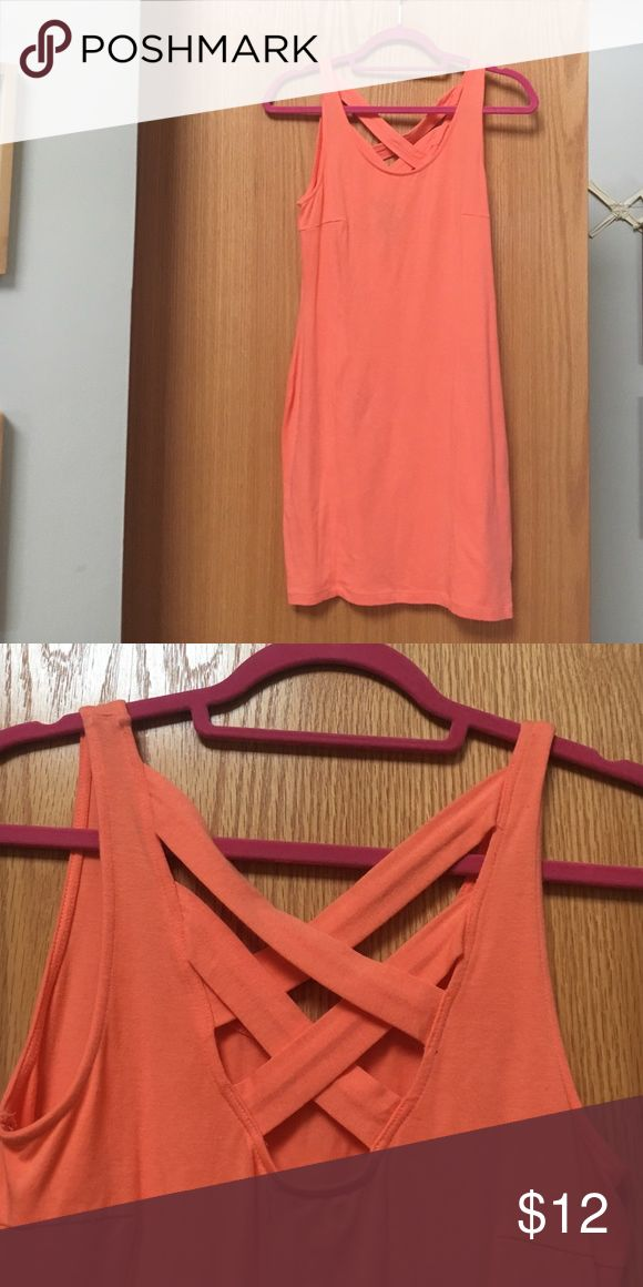 Never worn orange body con dress This neon orange body con dress I picked up from PAC sun a while back and just forgot I had it. It's got beautiful criss cross detailing in the back that adds some detail to an otherwise simple dress. Nollie Dresses Mini