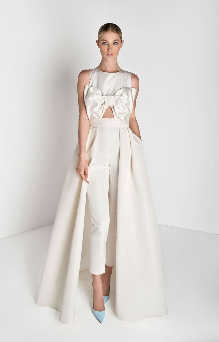 Silk duchesse satin top, silk faille pants 	High round neckline, sleeveless 	Oversized bow and cutout on front 	Back opening, with crystal detailing 	Cigarette style trousers 	Concealed bac...