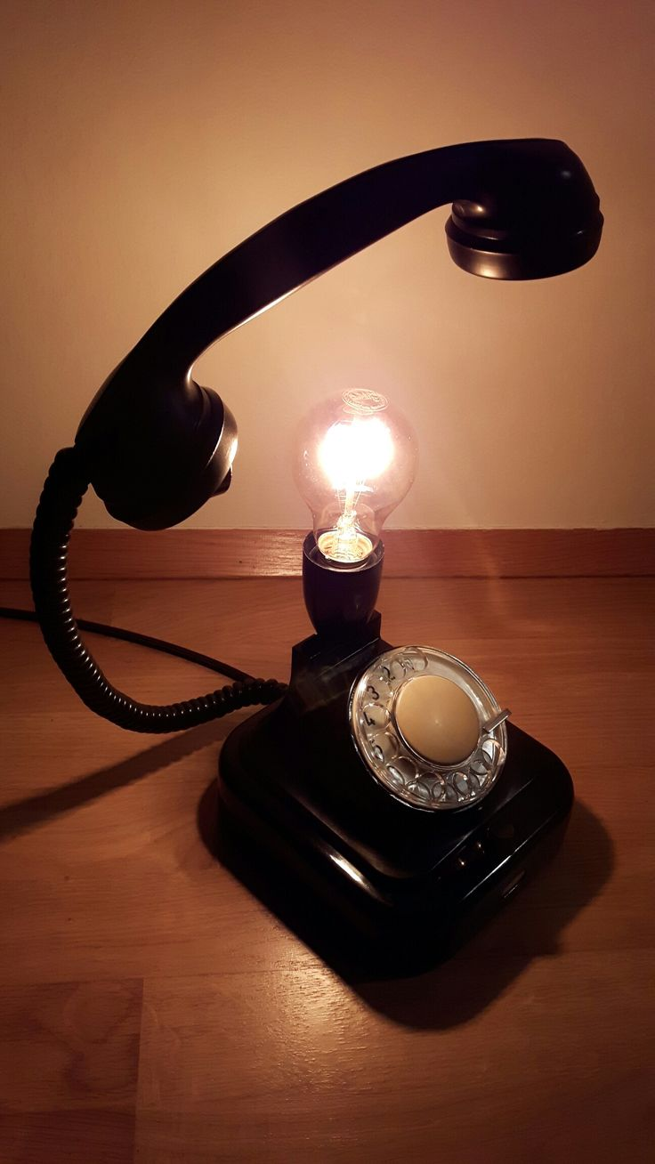 """""""Off the hook"""" lamp, out of an old telephone bought from a market in Prague."""
