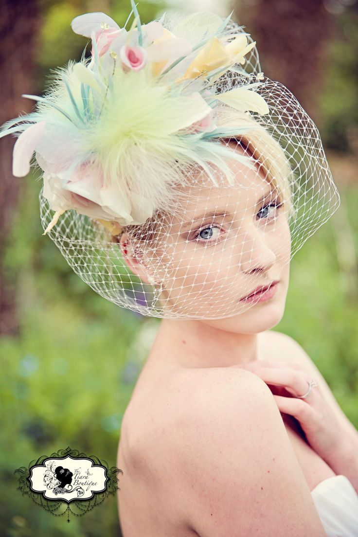 Candy Floss inspired pastel fascinator with bird cage veil  Photography - Lucylou Photography www.lucylouphotography.com  Accessories/bouquets - The Tiara Boutique www.facebook.com/thetiaraboutique  Hair and Make Up - https://www.facebook.com/pages/AAB-Wedding-Event-Specialist/1418049861766058