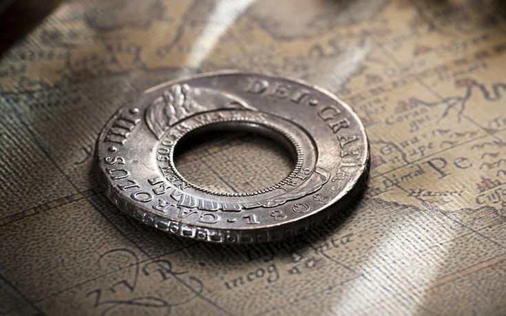 A collector has paid a world record Aus $ 495,000 for one of Australia's first coins, known as the Holey Dollar. The coin is one of 40,000 Spanish Silver Dollars that Governor Lachlan Macquarie bought in 1812 to solve a currency shortage in the fledgling penal colony of New South Wales. Macquarie enlisted the help of a convicted forger, William Henshall, to cut a hole in the centre of each to prevent the coins leaving the colony in payment of imports. The resulting donut was then stamped