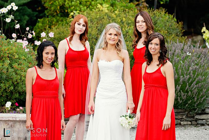 Beautiful bride and bridesmaids in red