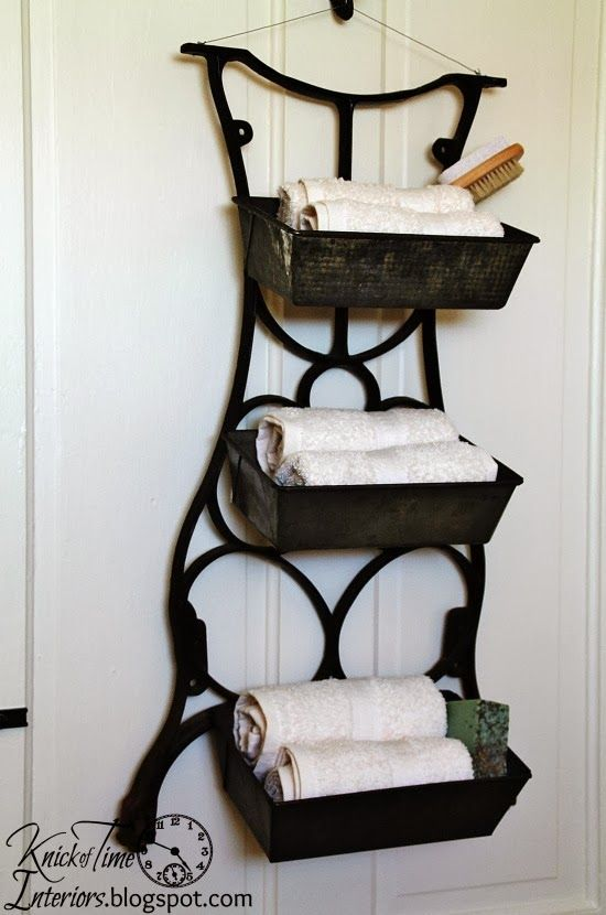 Repurposed Antique Sewing Machine Stand into Wall Bins. I like this idea but would find a different way to hang it.