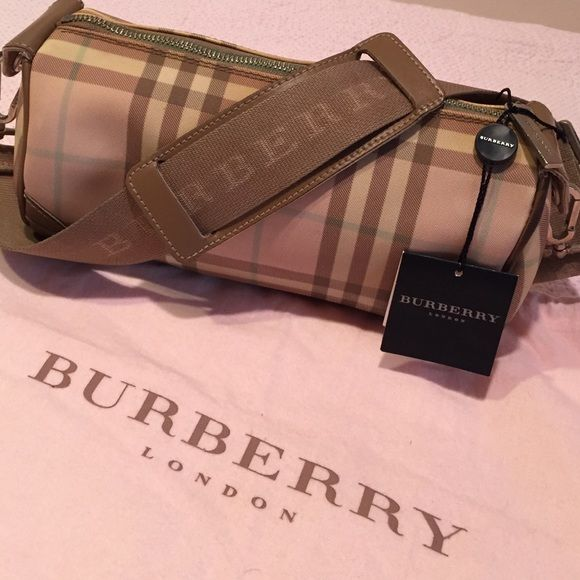Authentic Burberry roll bag SALE Tan, white, teal and pink checkered pattern. Authentic Burberry roll bag. Adjustable strap. Bag is in like new condition. Burberry Bags Shoulder Bags