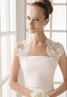 pretty bolero. Love how the lace curves in at the neckline.