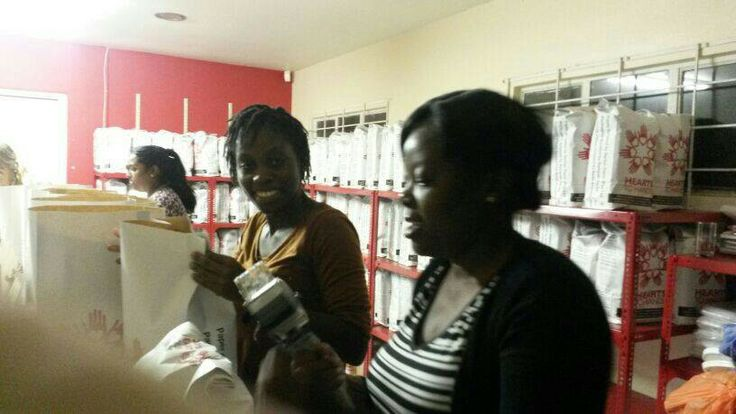 A life group help with food parcel packing