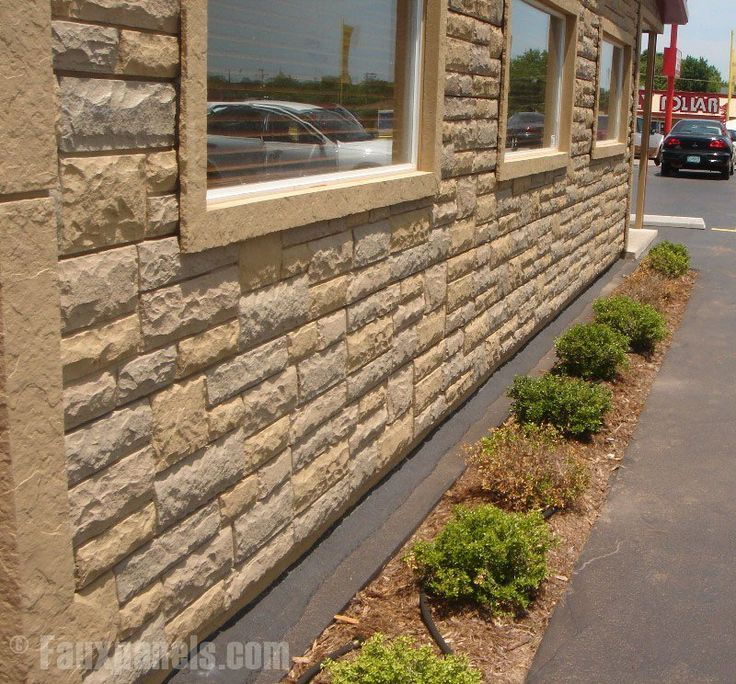 Fake rock panels, corners and window trim create a complete  look for this business's exterior