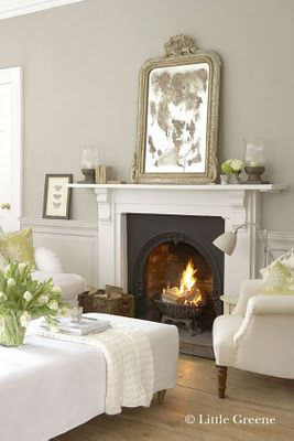 Fireplace set off by french grey paint and antiqued mirror