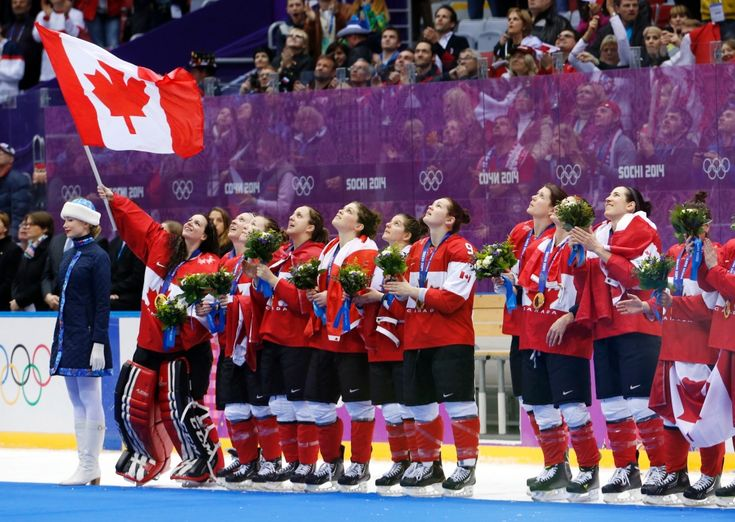 Team Canada sings the Canadian national anthem after receiving their gold medals after beating the USA 3-2 in overtime of the gold medal hockey game at the 2014 Winter Olympics in Sochi. (AP / Mark Humphrey)