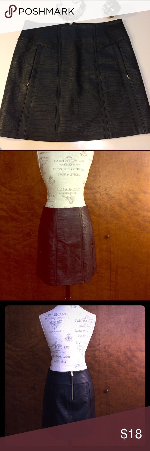 """""""Leather"""" Skirt with Pockets Like new. I love the look of this skirt, and love that it has pockets! Viscose, polyurethane, polyester (not leather), with polyester lining. Size M- waist about 15.5"""" across, hips about 17.5"""" across,  length 16"""". Sfera Skirts Mini"""