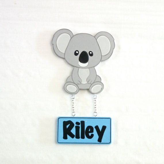 Kids Koala door sign. Kids wooden name signs look fantastic displayed on your childs door, bedroom or play rooms. Custom kids name signs make a wonderful personalised gift for any occasion. Each door plaque is personalised and hand painted just for you. Door signs are varnished for added protection. This also allows the plaque to be easily wiped cleaned with a damp cloth. Colours can be customised to match you nursery decor.  This listing is for a Kids Koala Boy Door Sign /Plaque.  Motif...