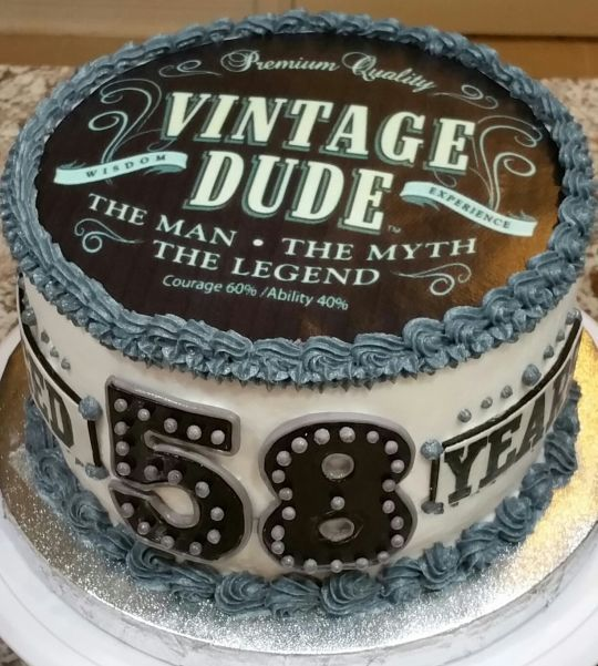"Popular ""Vintage Dude"" themed birthday cake"