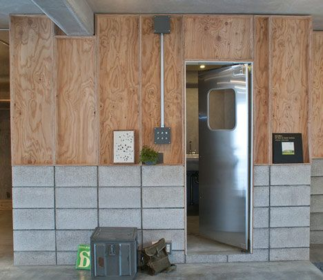 The door of the bath room is stenless swing door which are often used at kitchen space or back yard of the restaurant.The door match with counter material, the mortar floor, concrete blocks, stenless, larch wood.