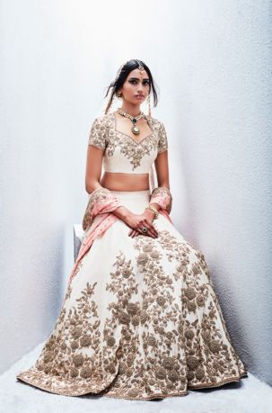 An ivory lehenga with antique filigree floral motifs by Sue Mue - love it for a bride!