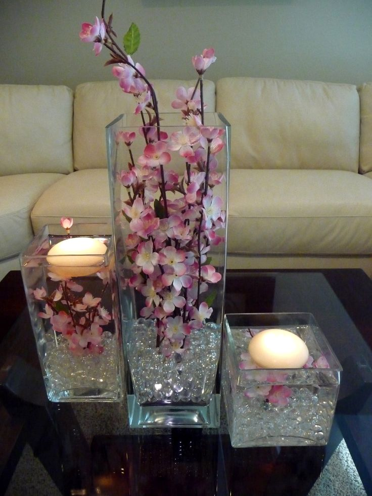 Cherry Blossoms and floating candles in a 3 Piece square vase set. Floral & color choices available. Call for pricing 912-231-8781 Rent in the Savannah/ Hilton Head area for $30.00 plus delivery.vendors: Savannah Event Decor