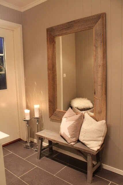 Cute entryway. Love the big mirror with bold frame.