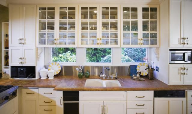 Love these kitchen cabinets. And the view to the backyard as well.