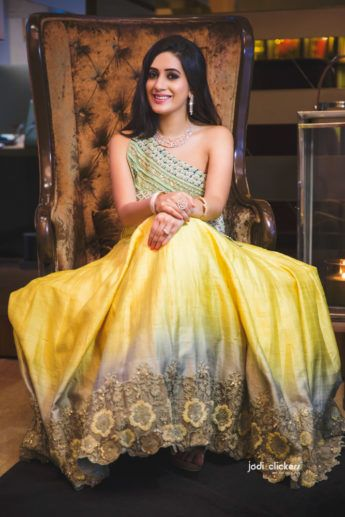 Light Lehenga - Bride in a Yellow and Blue Ombre Lehenga with an Off-Shoulder Blouse | WedMeGood #wedmegood #indianbride #indianwedding #bridal #yellow #blue #ombre #lightlehenga #lehenga #sangeetlehenga #weddinglehenga