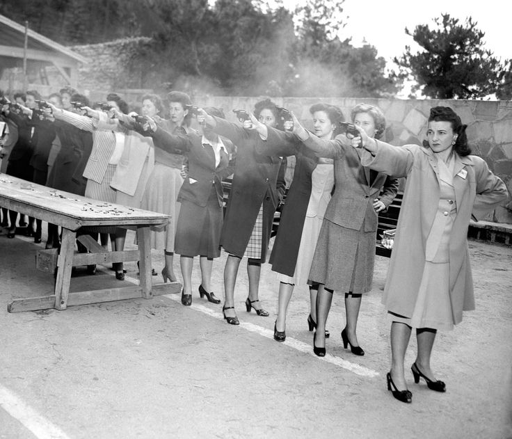 Female trainees of the Los Angeles Police Department practice firing their newly issued revolvers on March 6, 1948.