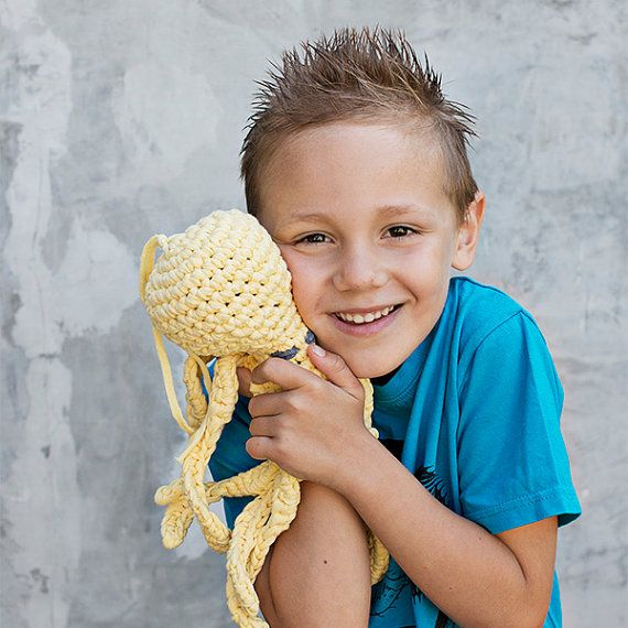Yellow crocheted octopus made with eco yarn perfect for