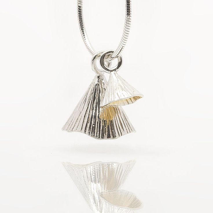 Designer Irish jewelry pendant. Handmade 2 piece sterling silver pendant hand-plated with 22 carat gold. Shell Cone collection by Martina Hamilton.