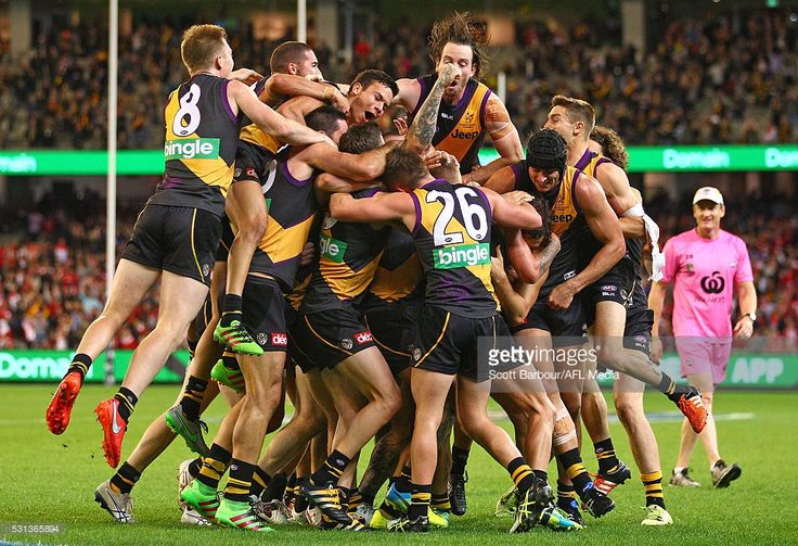 Sam Lloyd of the Tigers is congratulated by his teammates after kicking the match-winning goal after the final siren during the round eight AFL match between the Richmond Tigers and the Sydney Swans at the Melbourne Cricket Ground on May 14, 2016 in Melbourne, Australia.