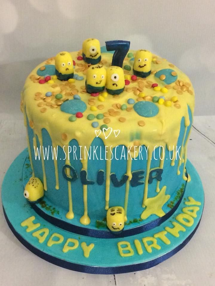 Here's a simple minions themed drip cake for a lucky birthday boy. The drip was made using a mixture of white chocolate callets and yellow candy melts, which is a great combination if you don't get along well with a traditional ganache! The minions were simple and made from a bean shaped piece of yellow fondant with the facial and clothing details painted on with edible paint and markers.