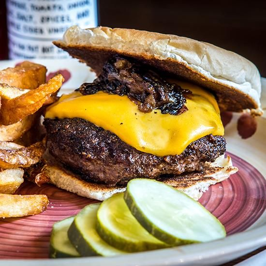 NYC: Brindle Room--Signature Burger: Sebastian's Steakhouse Burger, Chef Jeremy Spector's super-flavorful patties combine a 21-day dry-aged beef blend with fatty deckle. They're seared on a cast-iron skilled before they're topped with melted American cheese & caramelized onions.