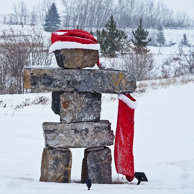 "Santa, Inukshuk style ""Inukshuk, the singular of inuksuit, means ""in the likeness of a human"" in the Inuit language. They are monuments made of unworked stones that are used by the Inuit for communication and survival. The traditional meaning of the inukshuk is ""Someone was here"" or ""You are on the right path."""
