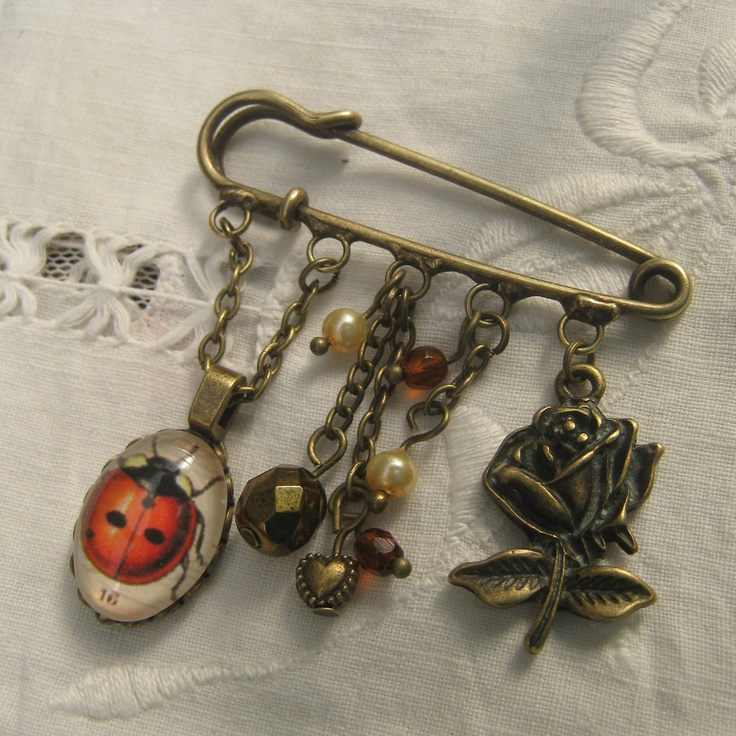 Kilt pin brooch with ladybird.