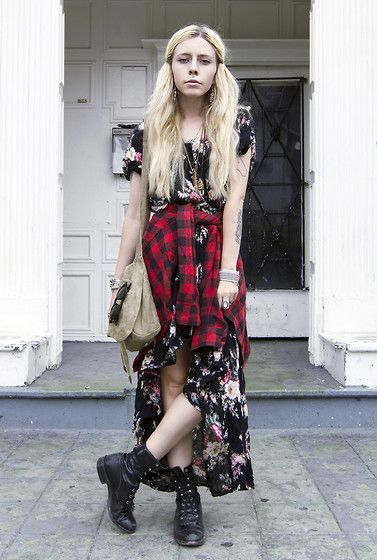 Grunge look in a long floral dress and plaid shirt tied around the waist x