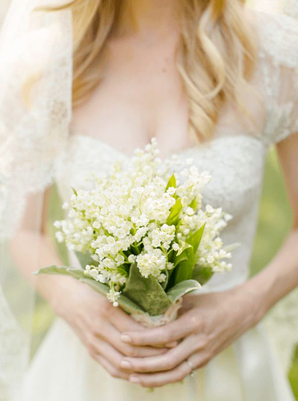 the prettiest lily of the valley bouquet via once wed