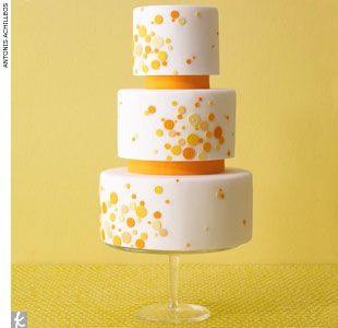 White wedding cake with orange and yellow polka dots by EatCakeBeMerry, EatCakeBeMerry.com  > Find your wedding cake baker