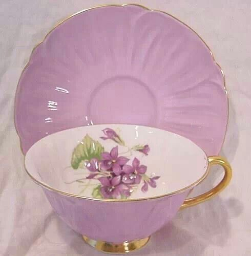 Beautiful light purple tea cup & saucer trimmed with gold...with violets inside.