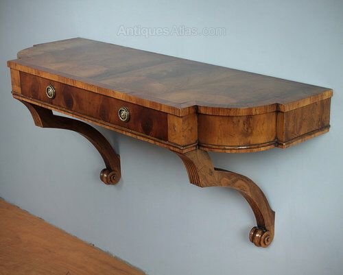 Image from http://images.antiquesatlas.com/dealer-stock-images/collingeantiques/Yew_Wood_Wall_Mounted_Console__ac049a1677b.jpg.