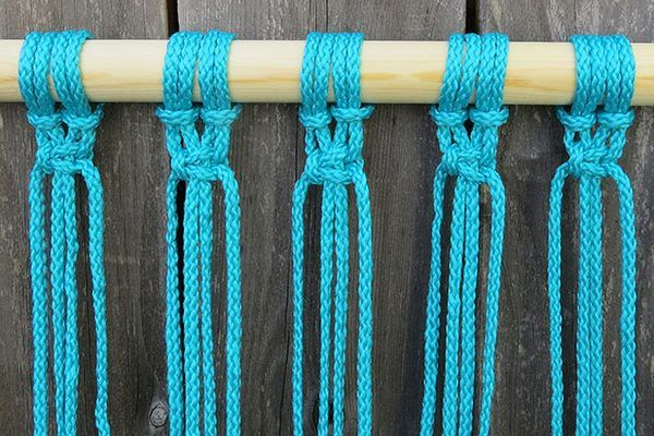 Pull the knot tight and continue with all the cords.