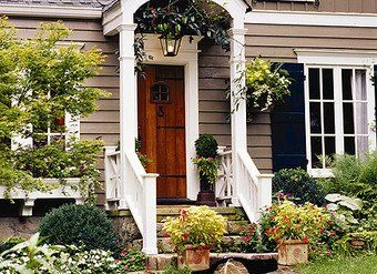 I like this scheme; beige, white and navy paint colors; wood door (to tie in the trees in our new yard?).