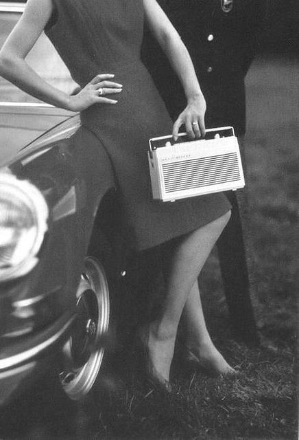 Woman holding a portable radio, photo by Walde Huth, 1960s.