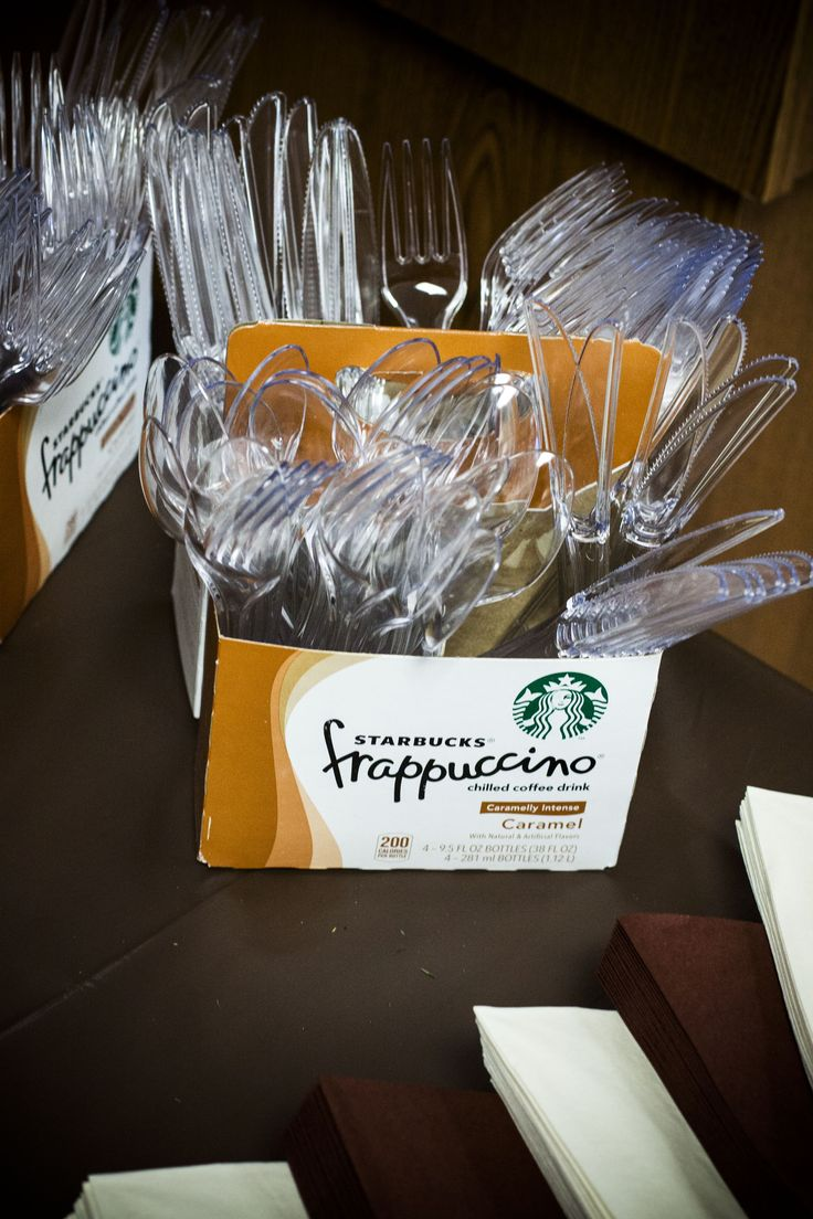 Starbucks boxes holding silverware.