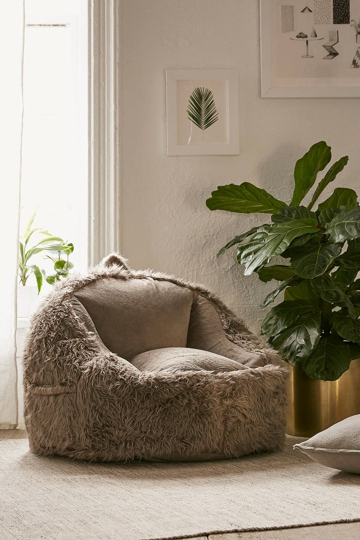 Shop Faux Fur Electronics Storage Bean Bag Chair at Urban Outfitters today. We carry all the latest styles, colors and brands for you to choose from right here.
