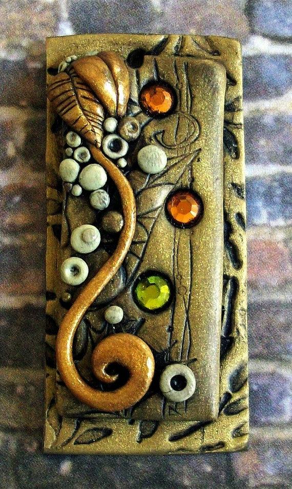 http://www.etsy.com/listing/53389395/secret-garden-pendant-with-glass-beads