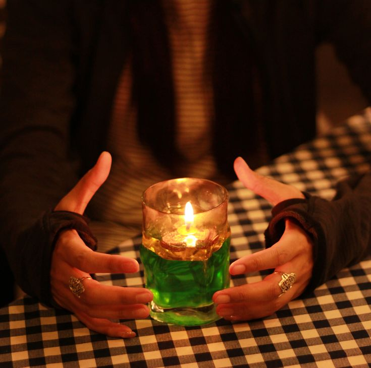 Caption: Witch's hand with half gloves and table candles. Royalty-free stock photo ID: 1027950970. Note: Picture illustration for related presentations about supernatural, energy, mystic, suggestion etc.