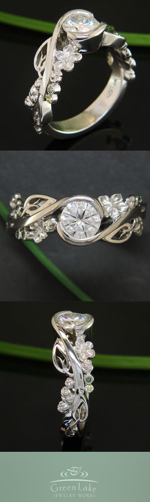 Custom white gold wrap style mounting with hand fabricated cherry blossoms.