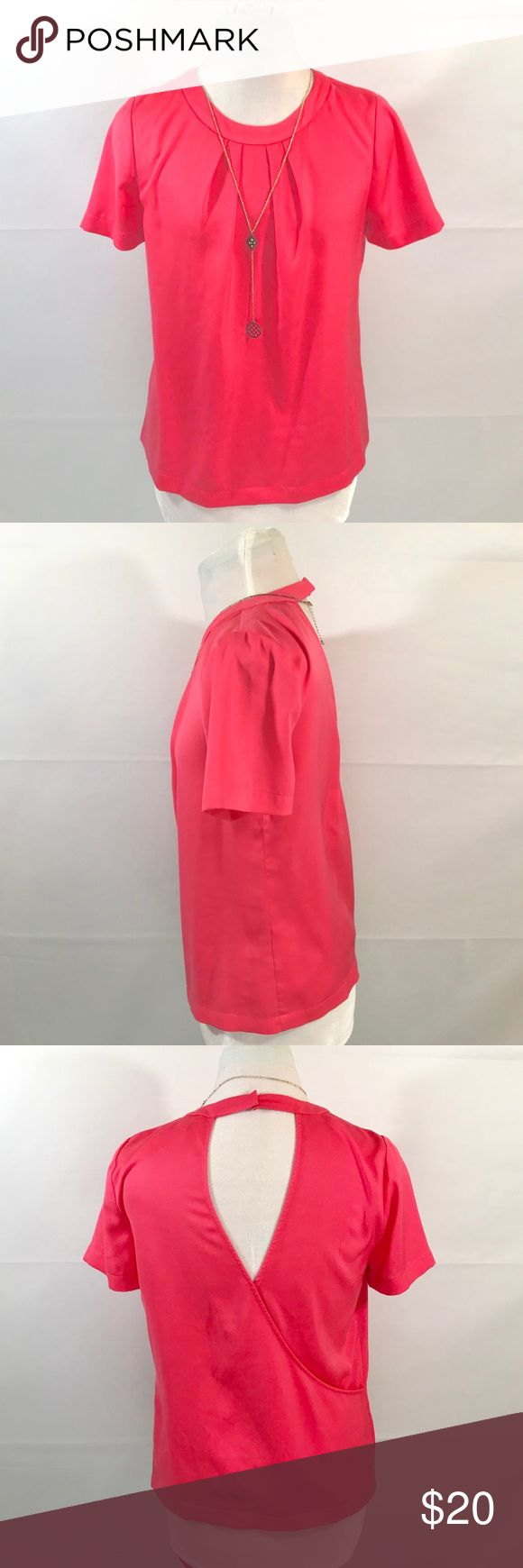 """J Crew Factory Pink Blouse w/ Crisscross Backing💖 This blouse is lightweight and perfect for the spring season. 🌷 This blouse can be paired easily with a pair of skinny jeans as casual wear or with black slacks for a more business look. The back has a stylish peek a boo design with crisscross lining. 👚🤩  Very clean blouse, No stains.  Size XS Measurements  Bust 18"""" Shoulder to shoulder 14"""" Length from back 23"""" 100% Polyester Feel free to ask me any questions  Offers Considered 🤗 J. Crew Factory Tops Blouses"""