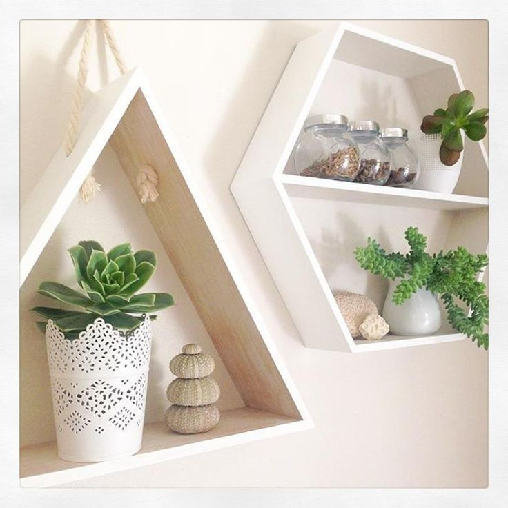 """""""Really loving how @newlifedesigns_ has filled a blank wall with @kmartaus triangle  and hexagon shelves/shadow box . Both have had a slight #kmarthack…"""""""