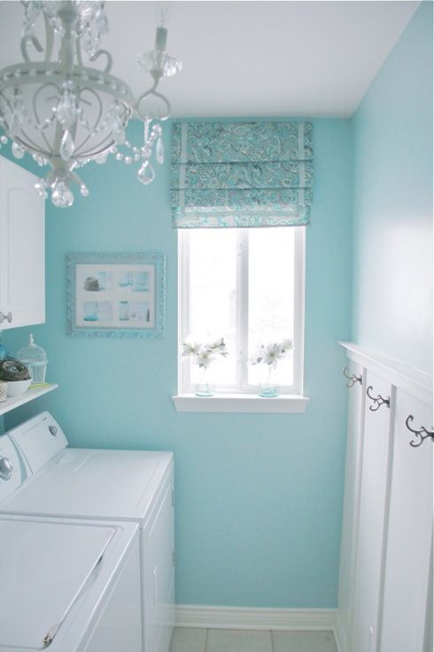 Cute teal laundry room. This would really look great with gold accents.